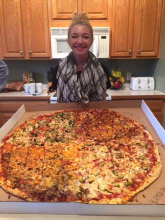 Andy's Hometowne Pizza: Madi and her GIANT birthday pizza!