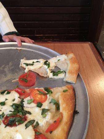 Blue Mountain Pizza and Brew Pub: Holes in the dough covered by cheese