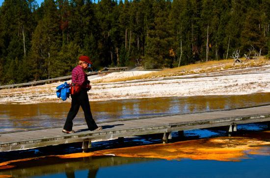 Upper Geyser Basin : Anita crosses boardwalk of Upper Basin