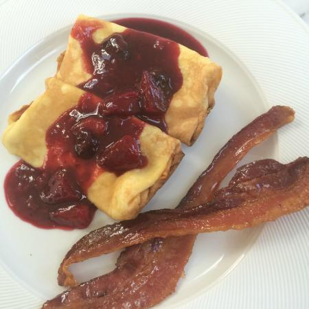 White Fences Inn: ricotta cheese blintzes with a mixed berry sauce and maple glazed bacon