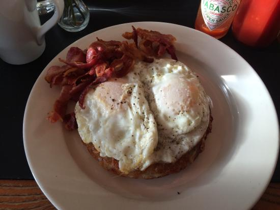 Cafe Select : Over easy eggs on Rosti with a side of bacon. Delicious.