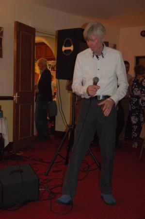 Llanfairfechan, UK: Rotarian Ron - or 'Rockin Ron' entertains at his own Birthday Party at the Split Willow