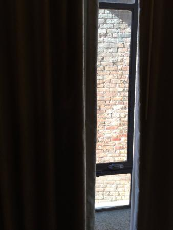 window view- brick wall- ask for something else if you desire more