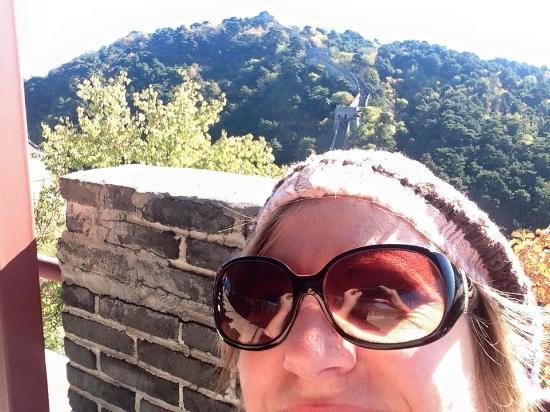 Shuifu County, China: Not overly fond of the selfie...but the wall is behind me.