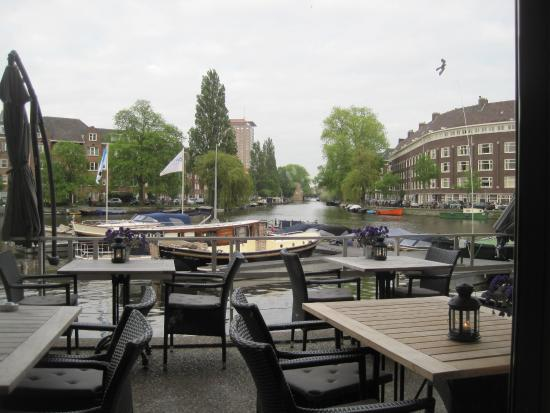 view from restaurant of outside terrace and canal. Black Bedroom Furniture Sets. Home Design Ideas