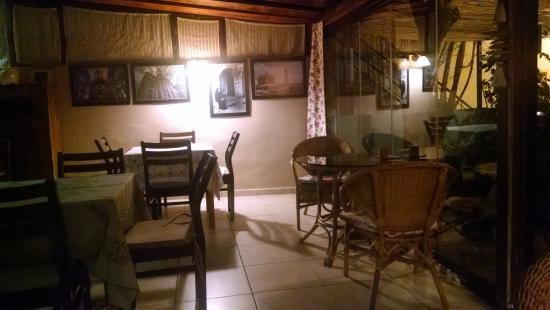 Gambilya Natural Cuisine: Historic photos on wall of comfortable dining area