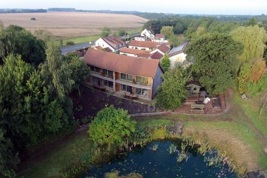 Great Fransham, UK: The Greenbanks Hotel from above the lake
