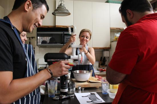 Stephanie is demonstrating at-home meat grinding  - Picture