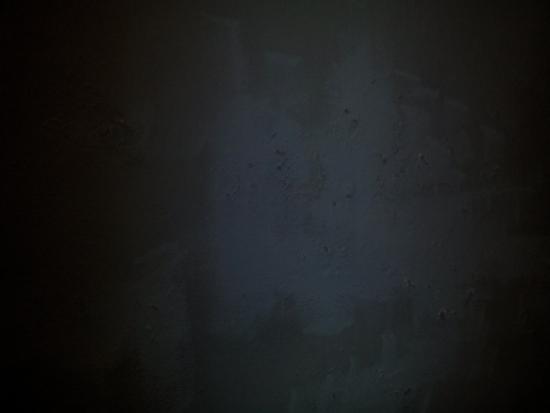 Rifugio degli Artisti : Muro dietro il letto
