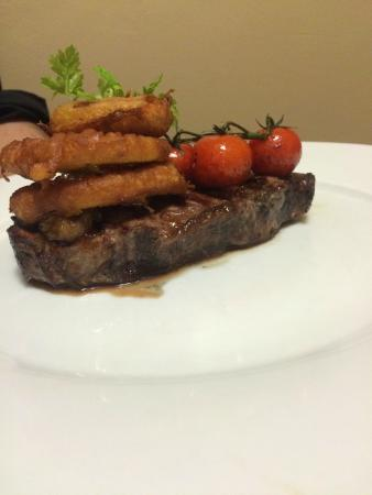 Seattle SteakHouse Restaurant: Steak with Onion ring & Grilled Tomato
