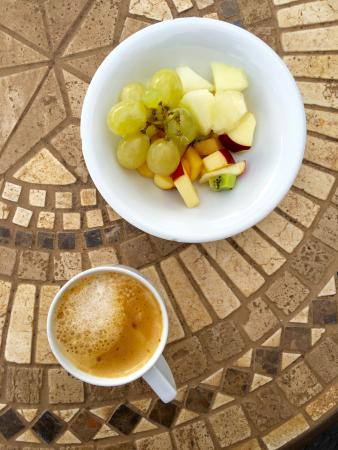 Delicious cappuccino and fruits.