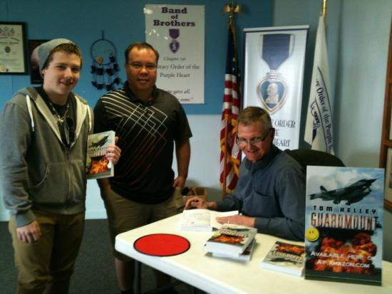 Peru, IN: Author Tom Kelley signing his latest book, Guardmount.