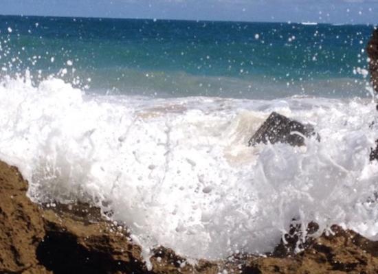 Waves crashing ocean front beach area - Picture of Condado