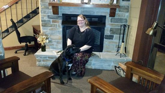 Saint Clair, MO: Staff Chrissy posing with service dog sitting on command