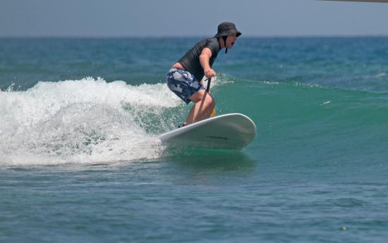 Bali Stand Up Paddle School: Marty on SUP after help from Jankie