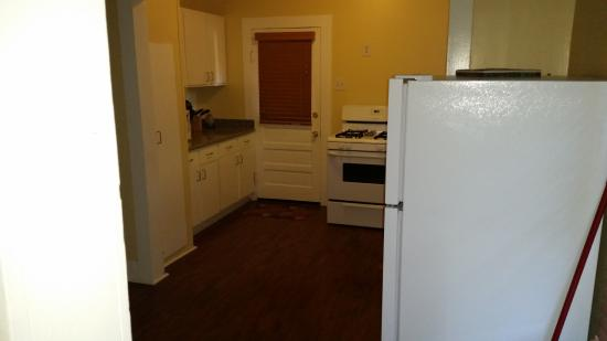 Blue Moon Guest House: Kitchen. Washer and Dryer to the left.