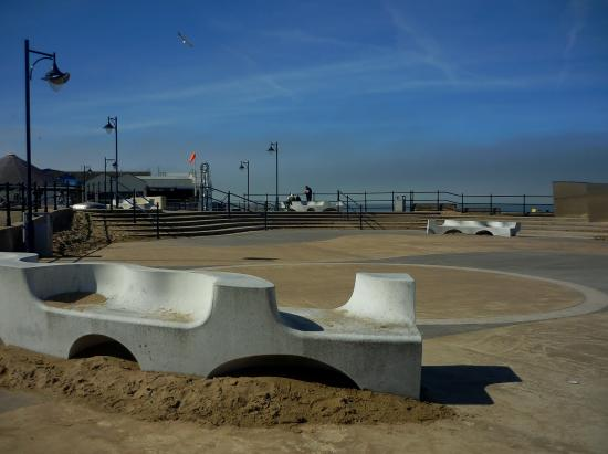 Funky seating and drifting sand on Central Beach promenade