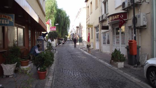 Hotel Baylan: View of the street - hotel entrance on the left (red sign)