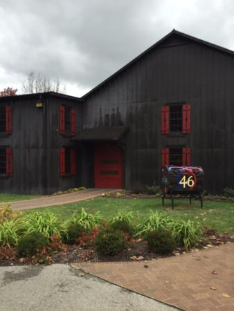 Loretto, KY: The dark wood represents the color of the bourbon and the red honors the red wax