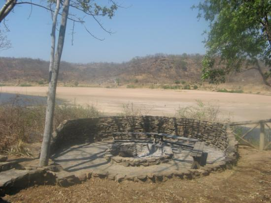 Bridge Camp: Fire place with Luangwa river bed below