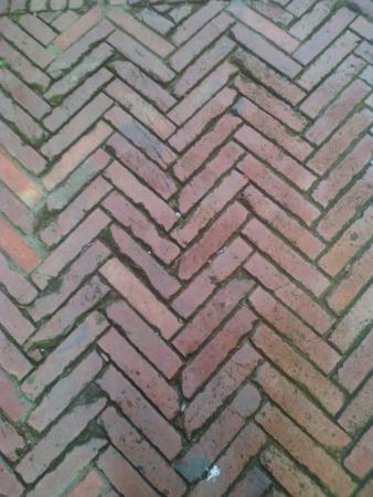 La Bellezza Geometrica Della Pavimentazione Di Una Via Foto Di