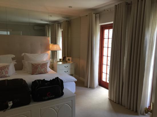 The Cellars-Hohenort: Bedroom and patio door view