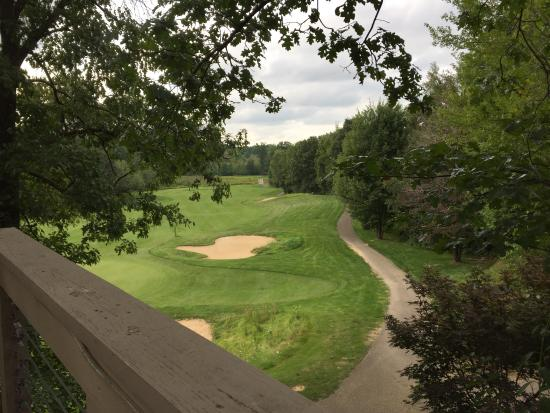 Augusta, MI: View of 18th hole on golf course from the restaurant deck