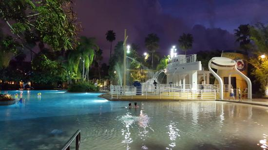 Pool at night picture of loews royal pacific resort at for Pool show orlando 2015