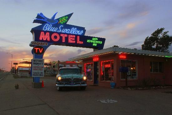 Blue Swallow Motel: Sunset is an ideal time to photograph the classic neon sign.