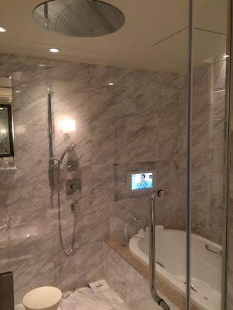 The Tokyo Station Hotel: Deluxe Palace Side Bathroom - Large tub with integrated TV and spacious shower space.