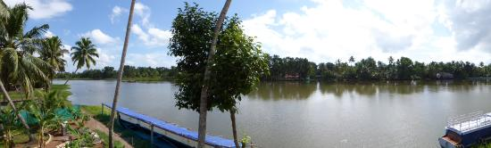 Ayana's Homestay: View over the water way from upstairs deck.
