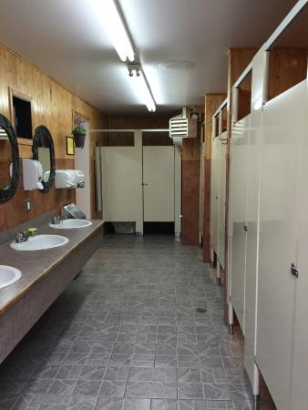 Extremely clean, tiled, bathroom