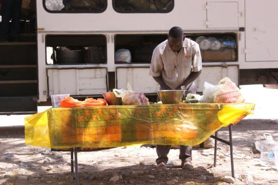 Karibu Safari: Jaison cooking lunch