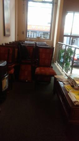 Big Thumb : Unsightly stack of chairs at the entranceway