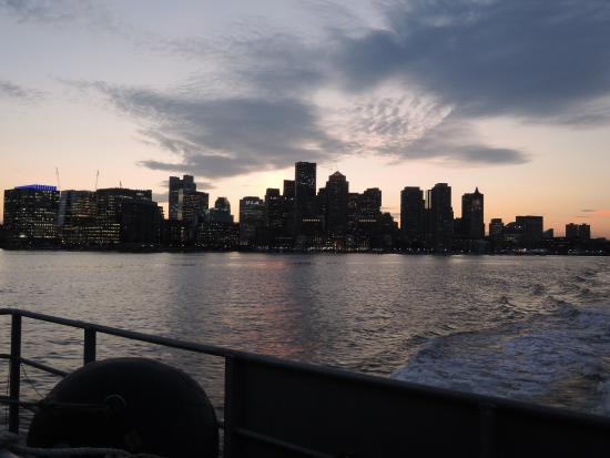 view at night from the Hull ferry leaving Boston