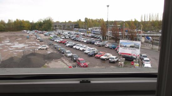 B Hotel: car parking and train station seen from room window