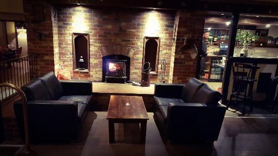 Newtownstewart, UK: The main Bar area with a cosy wood stove.... Relaxed and inviting