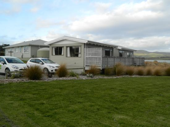 Waikava Harbour View: The two single cottages and their parking with 4 bedroom? lodge behind
