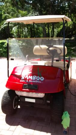 Bamboo Cafe & Smoothies: new red golf cart for shuttle or rent