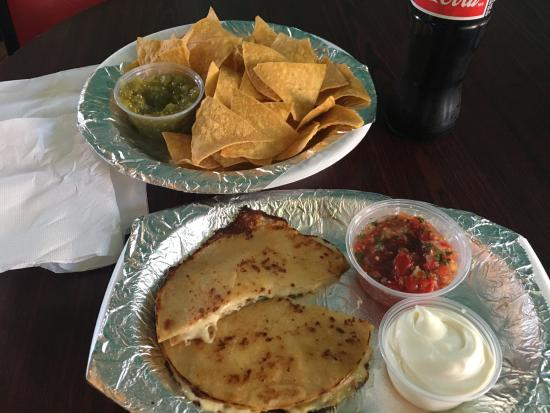 Chicken Quesadilla with salsa and sour cream and a side order of chips and salsa