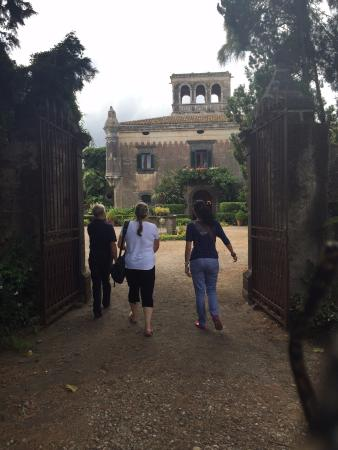 """TT Taxi Taormina : Stephanie (on right) and owner of the """"Corleone House"""" accompany me to the gate."""