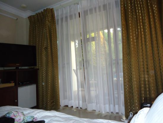 Golden Palm Resort: big curtained door with view from outside