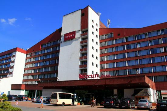 The Entrance Rear Side Of The Hotel And The Shuttle Minibus