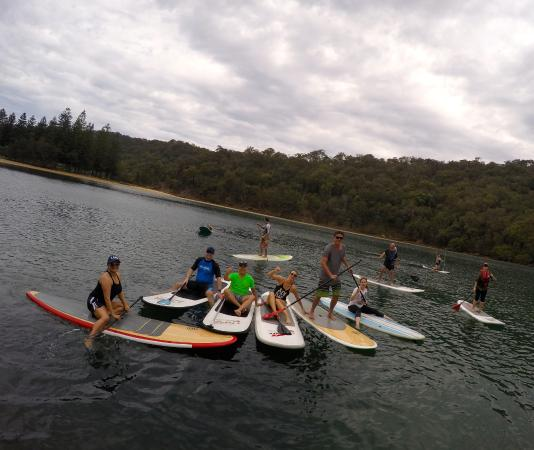 EcoTreasures: taking a break from paddling, having a laugh