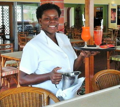 Sunset Shores Beach Hotel: Service with a smile - dining room, lounge on upper terrace