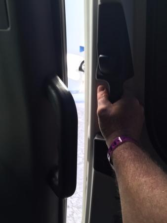 Cancun Fun Tours : Me holding the broken door closed while making other pick ups.