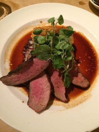 Celadon: Five spice-rubbed duck breast, fonduta grit cake, radicchio ...