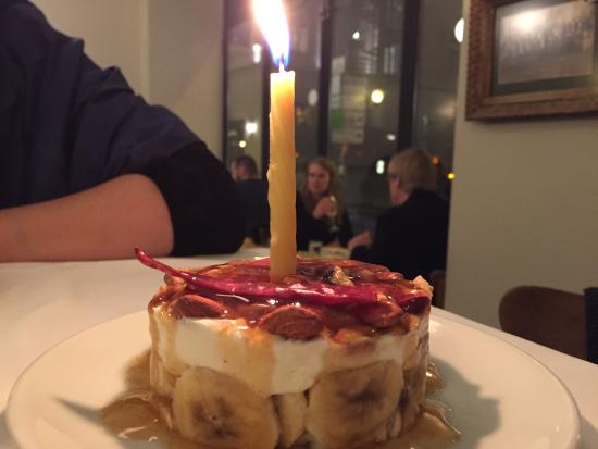 Meze By Lemon Tree: Delicious banana/almond dessert with birthday candle