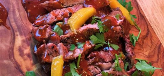 rib-eye steak with mango, corriander and hot jerk sauce