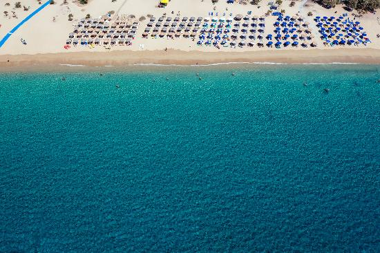 Aerial view of Agios Prokopios beach, with its crystal-clear waters and sandy coastline.